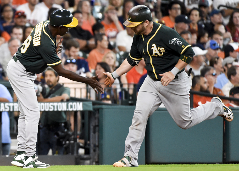 Stephen Vogt, right, will be the Oakland Athletics' only representative at the All-Star Game and that's just fine. It will give fans of his team a reason to tune in to the game.