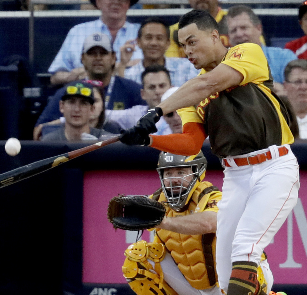 Giancarlo Stanton of the Miami Marlins was a total hit Monday night during the Home Run Derby portion of the All-Star events in San Diego. Stanton finished with a record 61 homers in the three rounds.