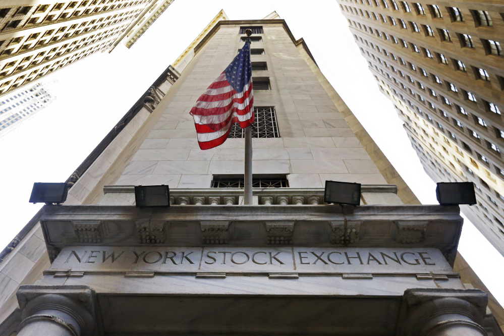 Stocks traded high on Wall Street on Tuesday, with the Dow Jones industrial average closing at a record level.