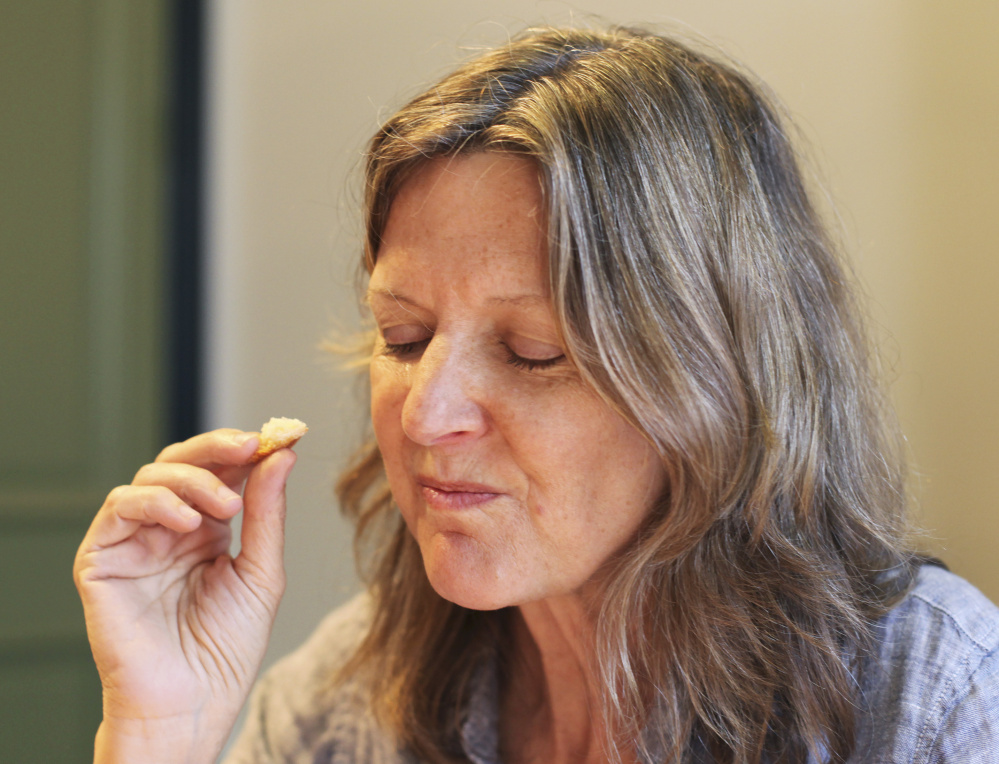 Alison Pray, co-owner of Standard Baking Co., inhales the scent of a demi-baguette while using a tasting chart developed by Michael Kalanty.