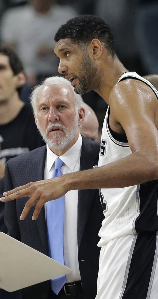 Spurs Coach Gregg Popovich and Tim Duncan won more games together than any player-coach combination in NBA history. Duncan retired Monday.
