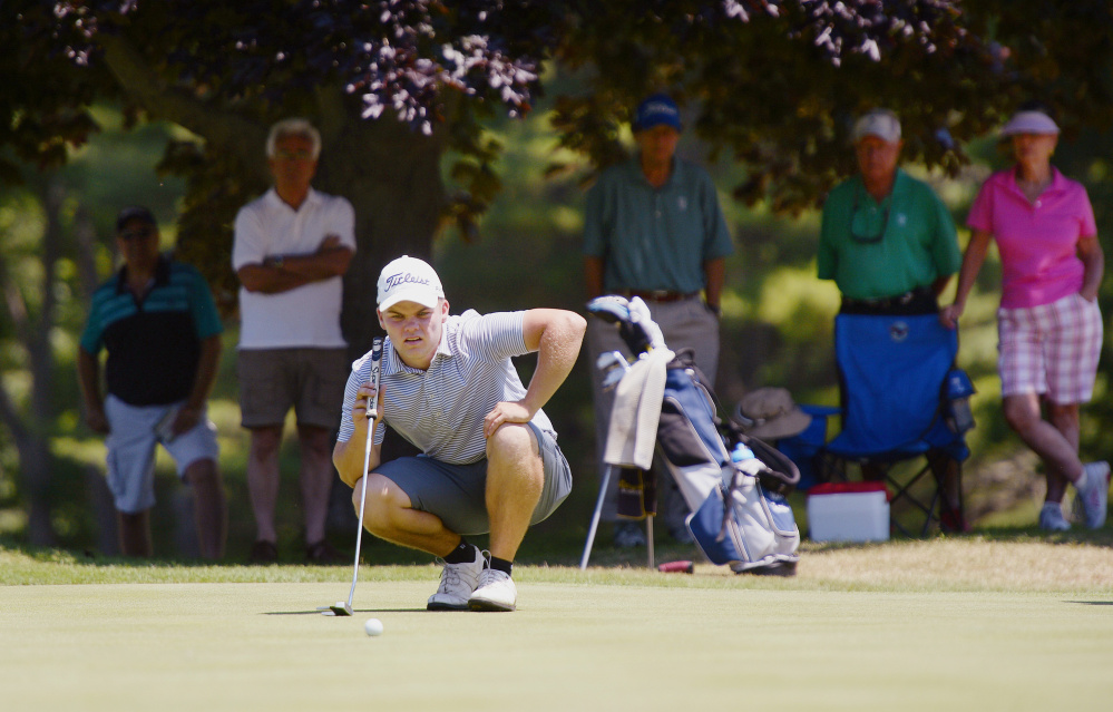 Matt Hutchins of The Woodlands Club in Falmouth lines up a shot on the 17th green during the 97th Maine Amateur golf tournament at the York Golf & Tennis Club Wednesday. (Shawn Patrick Ouellette/Staff Photographer)