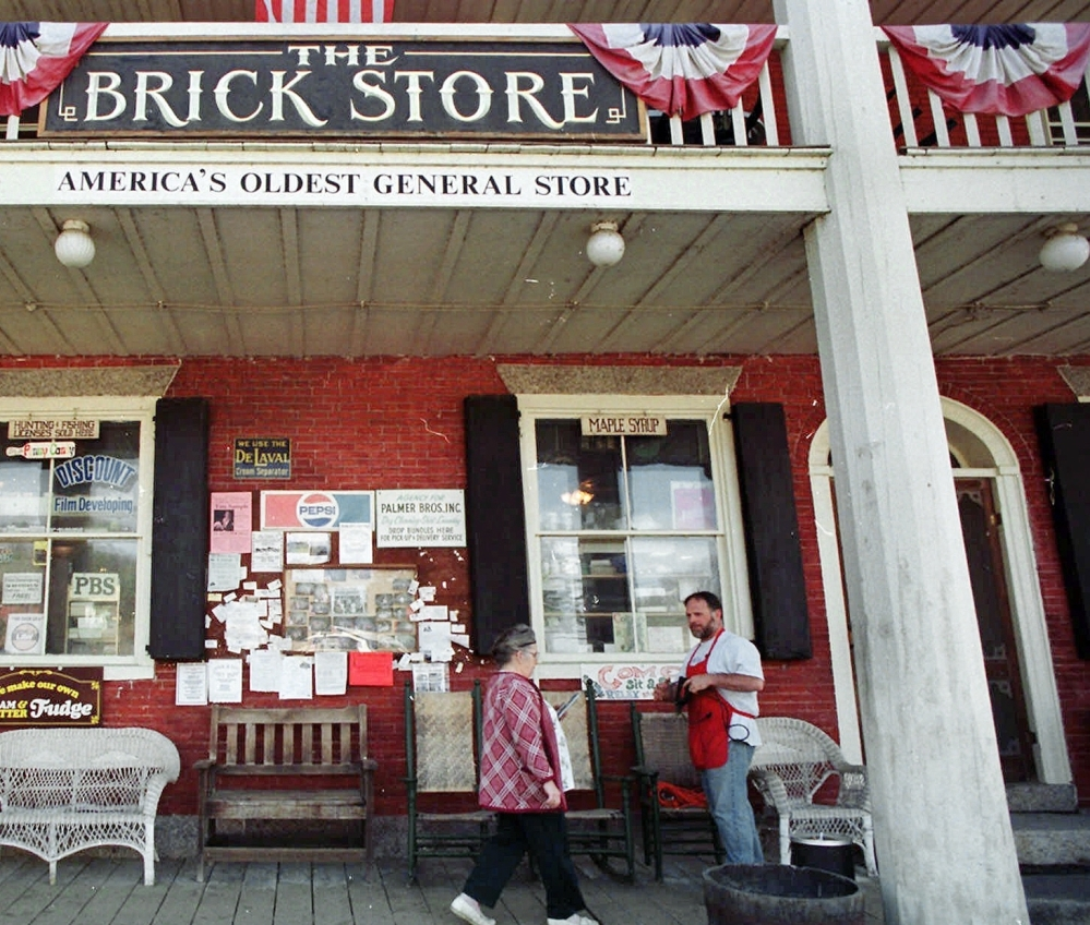 Mike Lusby greets customers on the porch of the Brick Store in 1999 in Bath, N.H. A local investor bought the property.