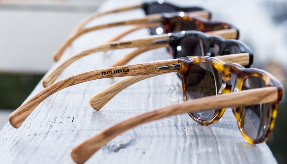 Traps Eyewear shades, priced at $240-$285, have salvaged lobster trap wood for temples. They're available at Rough & Tumble in Portland and Day Trip Society in Kennebunkport. Ben McCanna/Staff Photographer