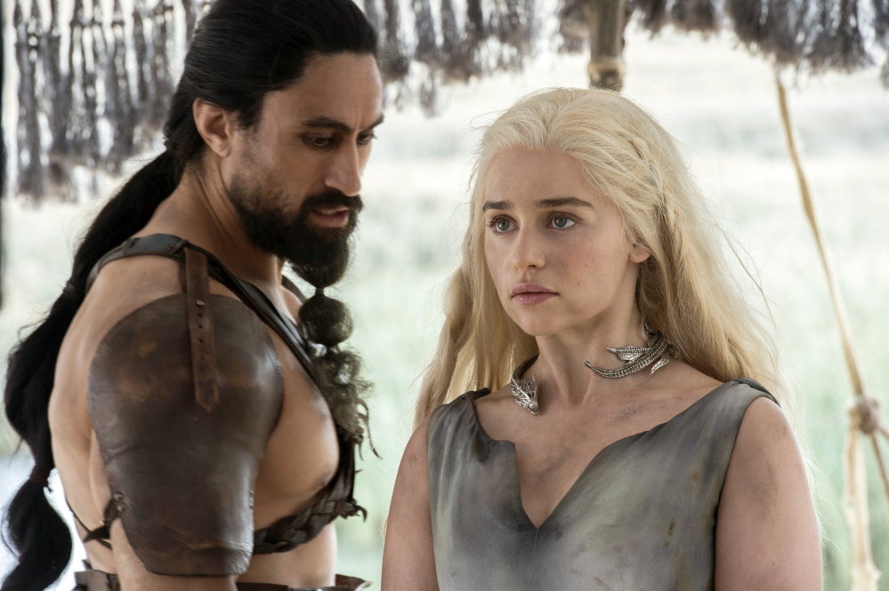 "Joe Naufahu, left, and Emilia Clarke in a scene from ""Game of Thrones."" Clarke was nominated for outstanding supporting actress in a drama series for her role."
