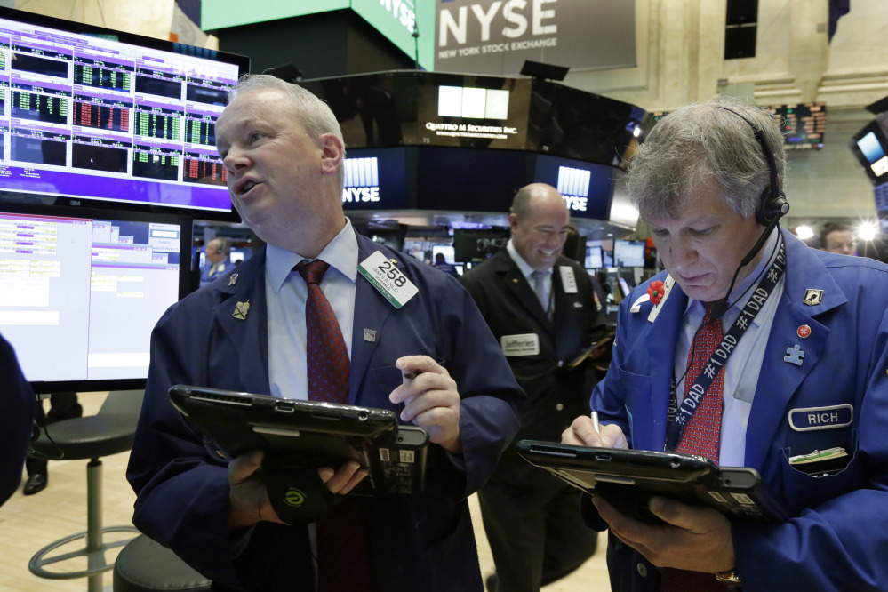 Trader James Riley, left, and Richard Newman work on the floor of the New York Stock Exchange on Thursday.