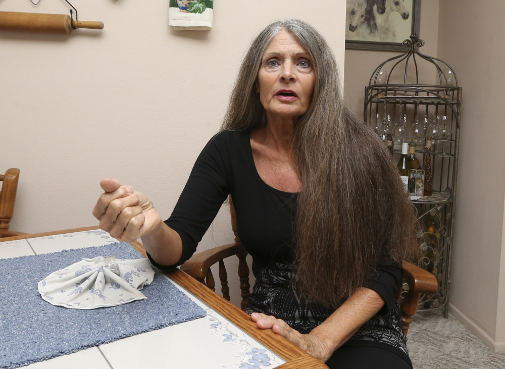 Roberta Berchtold is photographed at her home Thursday, July 7, 2016, in San Diego. Beneficiaries of unclaimed life insurance policies already have received billions of dollars _ and others could be in store for some unexpected cash. It's the result of state actions forcing companies to locate and pay heirs the money they are owed. Earlier this year, Berchtold was told by a nephew that Illinois was looking for her father's descendants because it was holding money from a life insurance policy. She thought the matter was settled two years ago, when the insurance company contacted her about a policy and sent her a check for $35,000. (AP Photo/Lenny Ignelzi)