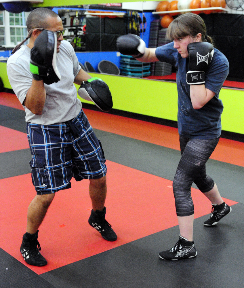 Boxing coach Chris Albee, left, and Katie Baker train on Tuesday in Manchester as she prepares for her first amateur boxing bout on Saturday in Lewiston.