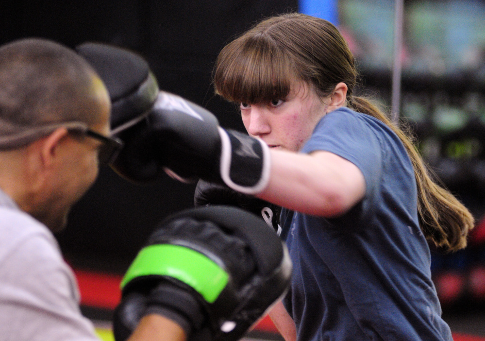 Boxing coach Chris Albee, left, and Katie Baker train on Tuesday in Manchester.
