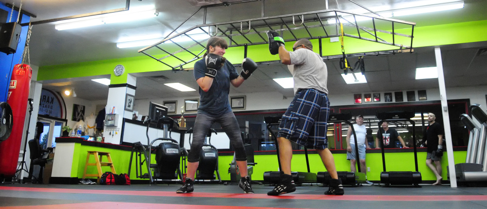 Katie Baker, left, and boxing coach Chris Albee train on Tuesday in Manchester.