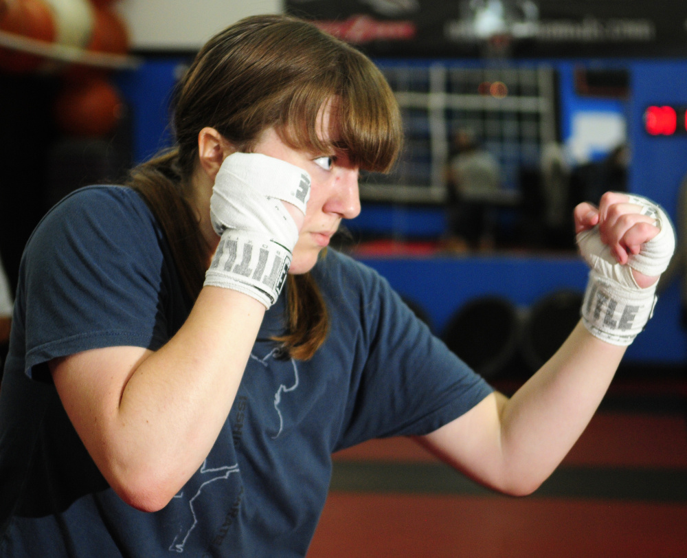 Katie Baker, 17, of Gardiner, shadow boxes facing a mirror on Tuesday in Manchester, where she was training for a fight scheduled for Saturday.