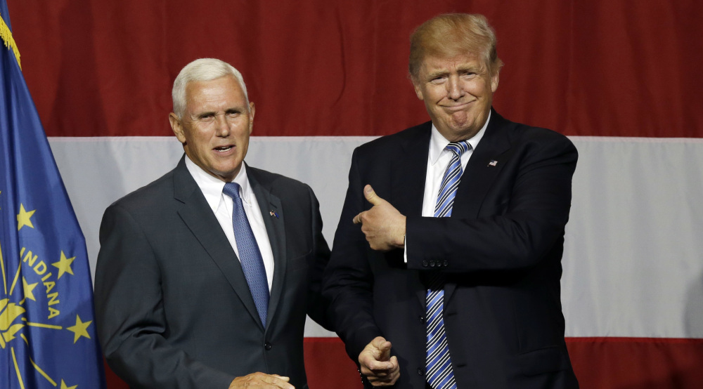 Indiana Gov. Mike Pence joins Republican presidential candidate Donald Trump at a rally in Westfield, Ind., on July 12. Pence's decision to join Trump on the ticket is at odds with his previous positions.