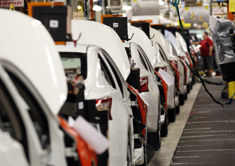 In this April 6, 2016, photo, an assembly line of new 2016 Altimas await backseat installations at the Nissan Canton Vehicle Assembly Plant in Canton, Miss. On Friday, July 15, 2016, the Federal Reserve reports on U.S. industrial production for June. (AP Photo/Rogelio V. Solis)