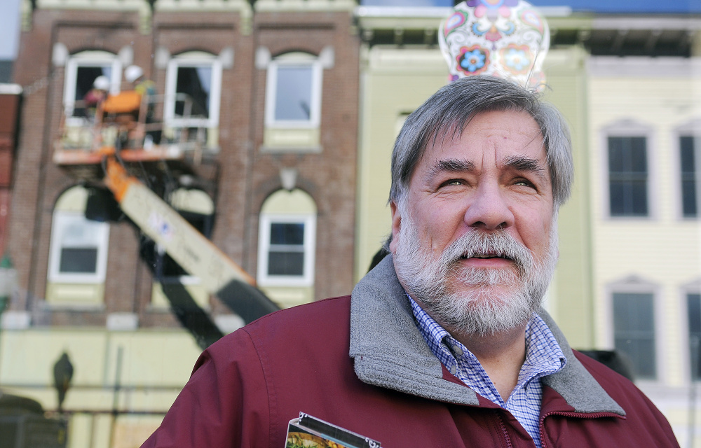 Gardiner Mayor Thom Harnett watches the demolition of 235 Water St. last November after a fire there in July.