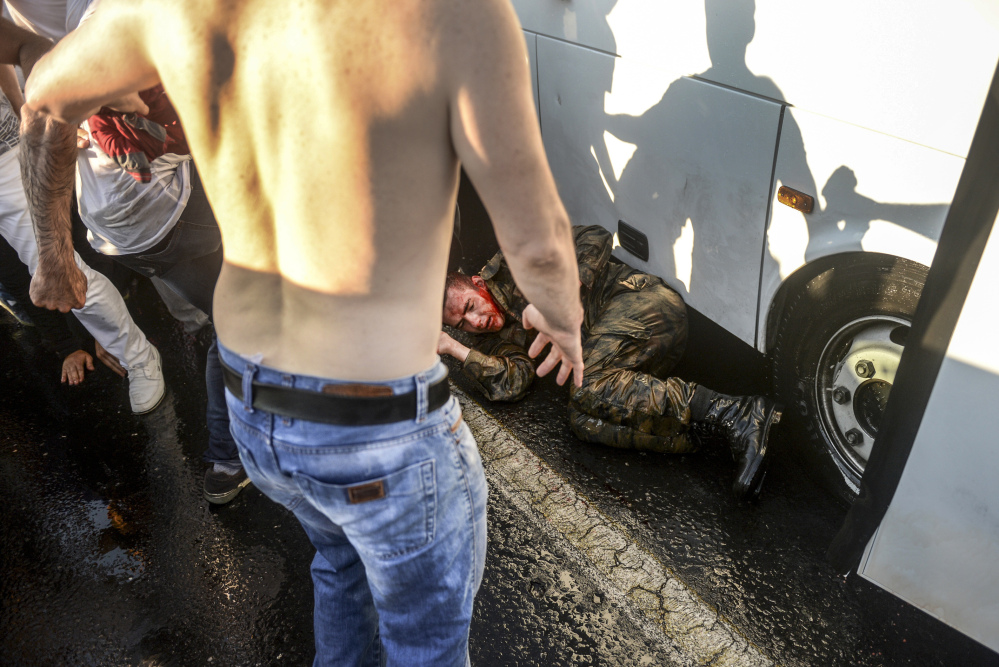 Turks assail a soldier who participated in the attempted coup.