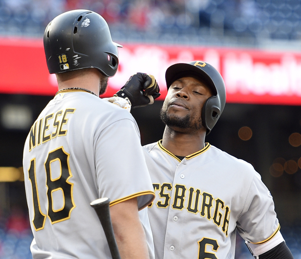 Starling Marte, right, celebrates his home run with Jonathon Niese in the 18th inning of the Pirates' 2-1 win over the Nationals in Washington.