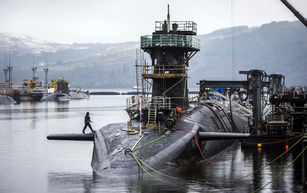 The Vanguard-class submarine HMS Vigilant, one of four Royal Navy submarines armed with Trident missiles, is shown at HM Naval Base Clyde, also known as Faslane, Scotland. British lawmakers voted Monday to replace the country's fleet of nuclear-armed submarines.