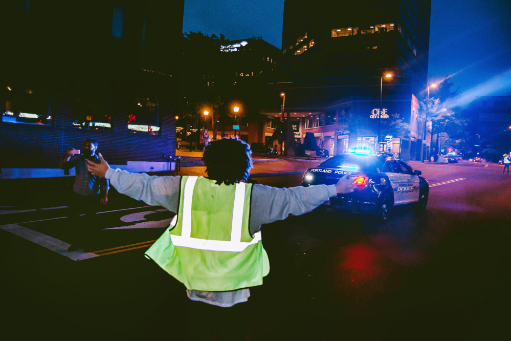 """Representatives of Kesho Wazo and the Portland branch of the NAACP met with police for hours before the march, which then went off without a hitch. """"I thought it was a highly successful event,"""" said Police Chief Michael Sauschuck. Photo by Dylan Greenlaw"""