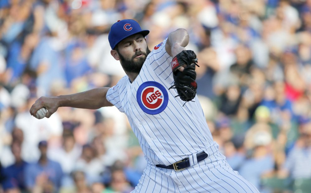 Chicago Cubs starting pitcher Jake Arrieta delivers during the first inning of a baseball game against the New York Mets Tuesday, July 19, 2016, in Chicago. (AP Photo/Charles Rex Arbogast)