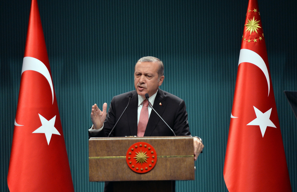 Turkey's President Recep Tayyip Erdogan speaks after an emergency meeting of the government in Ankara, Turkey, late Wednesday. Erdogan on Wednesday declared a three-month state of emergency following a botched coup attempt, declaring he would rid the military of the