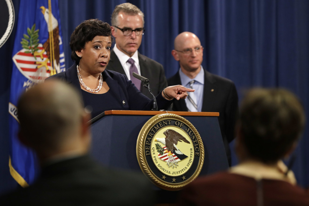 Attorney General Loretta Lynch, left, next to FBI Deputy Director Andrew McCabe and IRS Criminal Division Chief Richard Weber, speaks at a news conference, Wednesday, July 20, 2016, at the Justice Department in Washington, announcing that the U.S. government is seeking the forfeiture of more than $1 billion in assets that federal officials say were misappropriated from a Malaysian sovereign wealth fund. (AP Photo/Jacquelyn Martin)