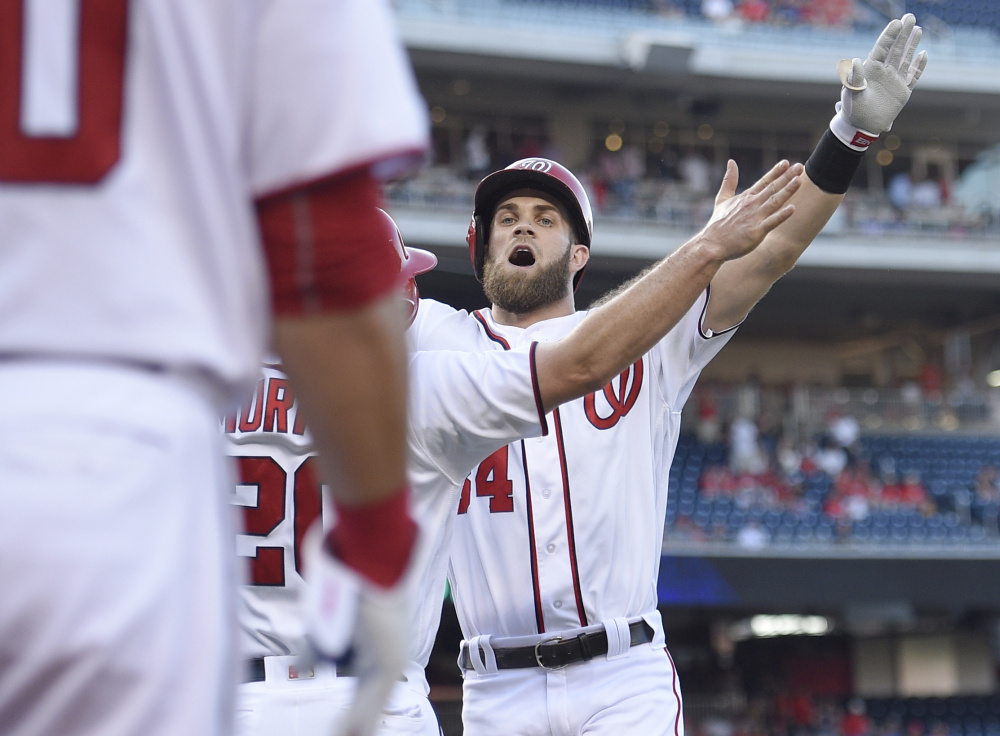 Washington's Bryce Harper celebrates his two-run homer in the first inning of an 8-1 win over the Los Angeles Dodgers Wednesday at Washington.