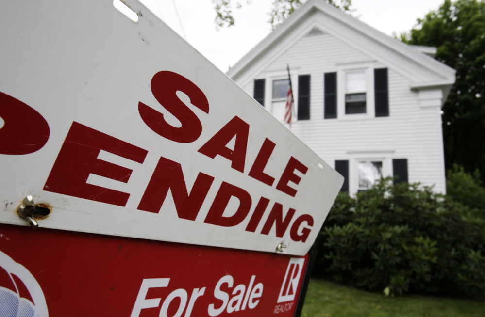 A sale pending sign sits outside a house in Bath. The median sales price for existing, single-family homes in Maine rose by 5.5 percent in June, according to a report issued Thursday by the Maine Association of Realtors.