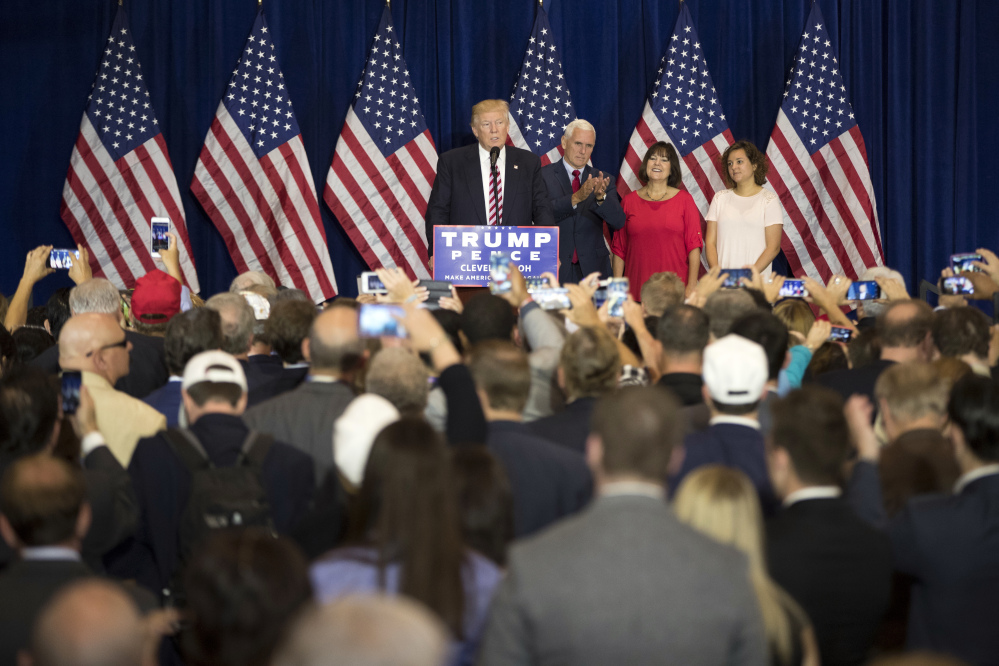 Republican presidential candidate Donald Trump speaks at an goodbye reception with friends and family following the Republican National Convention on Friday in Cleveland. Also appearing are vice presidential running mate Gov. Mike Pence, R-Ind., Karen Pence, and Charlotte Pence.