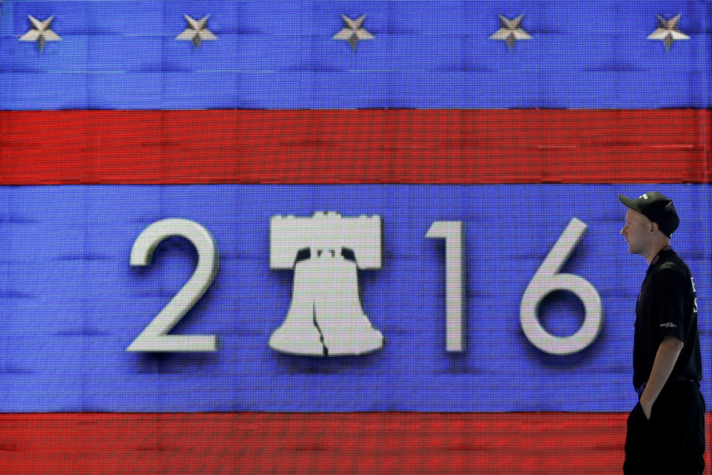 A worker walks past a video display during preparations for the 2016 Democratic National Convention on Friday in Philadelphia.  Associated Press/Matt Slocum