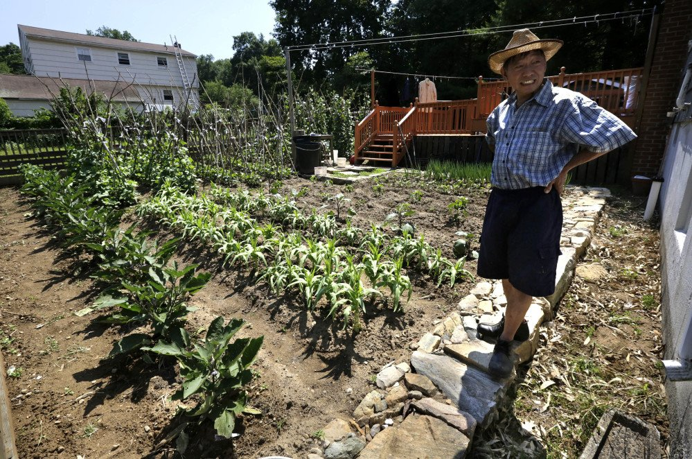 Xu Song Mu, a 62-year-old former Mohegan Sun worker who came from Queens, N.Y., with his family about eight years ago, turned the house's former yard into a large vegetable garden in Uncasville, Conn. A Chinese immigrant community has been growing around the Mohegan Sun and Foxwoods casinos for more than a decade, but some residents complain that the manicured yards of years past are being used for agricultural production.