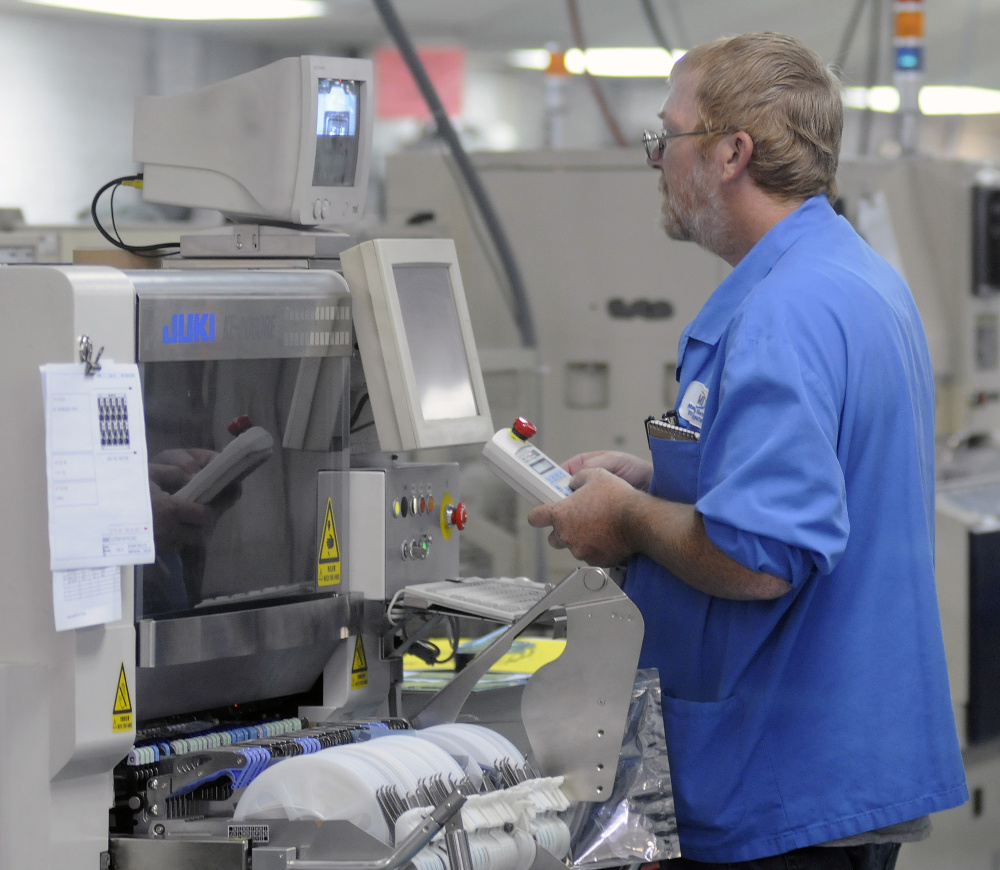 Ron Crocker works on a machine at Alternative Manufacturing Inc. in Winthrop. The company has added between 10 and 15 employees this year and is looking for five or six more workers to meet its production demands.