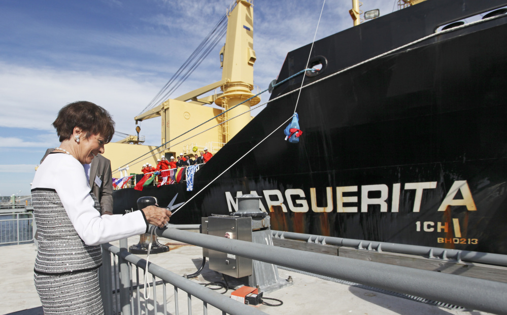 Marguerita DeLuca of  prepares to cut the rope for the christening of the MV Marguerita at the Ocean Gateway Terminal in Portland in July 2016.