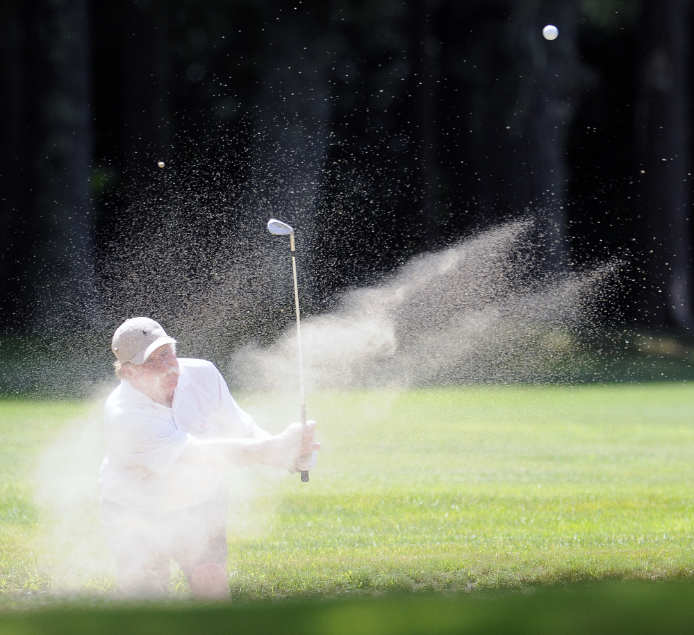 Mark Plummer blasts out of a bunker during the Maine Open at the Augusta Country Club in Manchester on Monday. Plummer shot a 2-over 72.