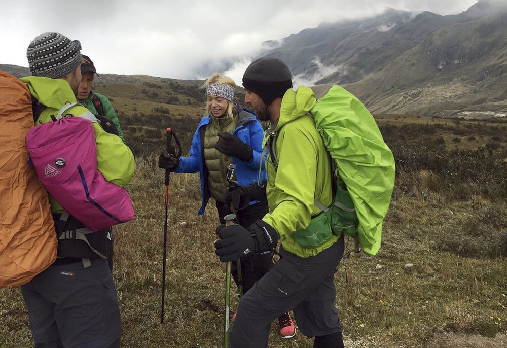 An uphill struggle doesn't faze Boston Marathon bombing survivor Adrianne Haslet, second from right, as she ascends Ecuador's Volcan Cayambe with a team of climbers and a guide, summitting the snow-capped mountain on Sunday with the help of a prosthetic leg.