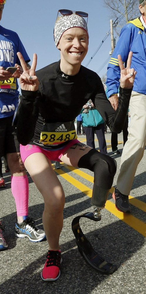 FILE - In this April 18, 2016, file photo, Boston Marathon bombing survivor Adrianne Haslet poses at the starting line in Hopkinton, Mass., before running in the 120th Boston Marathon. On Sunday, July 24, 2016, Davis reached the summit of Volcan Cayambe, Ecuador's third-highest mountain, with a team of climbers from the Range of Motion Project. The nonprofit group helps provide prosthetic limbs to people around the world who don't have access to them. (AP File)