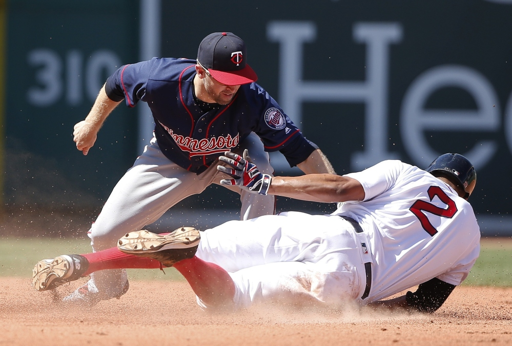 Minnesota's Brian Dozier, left, misses the tag as Boston's Xander Bogaerts (2) steals second base during the fifth inning.