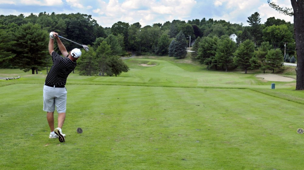 Ted Brown tees off on the first hole during the Charlie's Maine Open at the Augusta Country Club in Manchester on Tuesday.