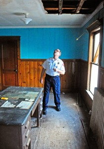 Fire Chief Mike Grant looks at his former office in the 1899 section of the building during a tour on Wednesday of the Hallowell fire station.