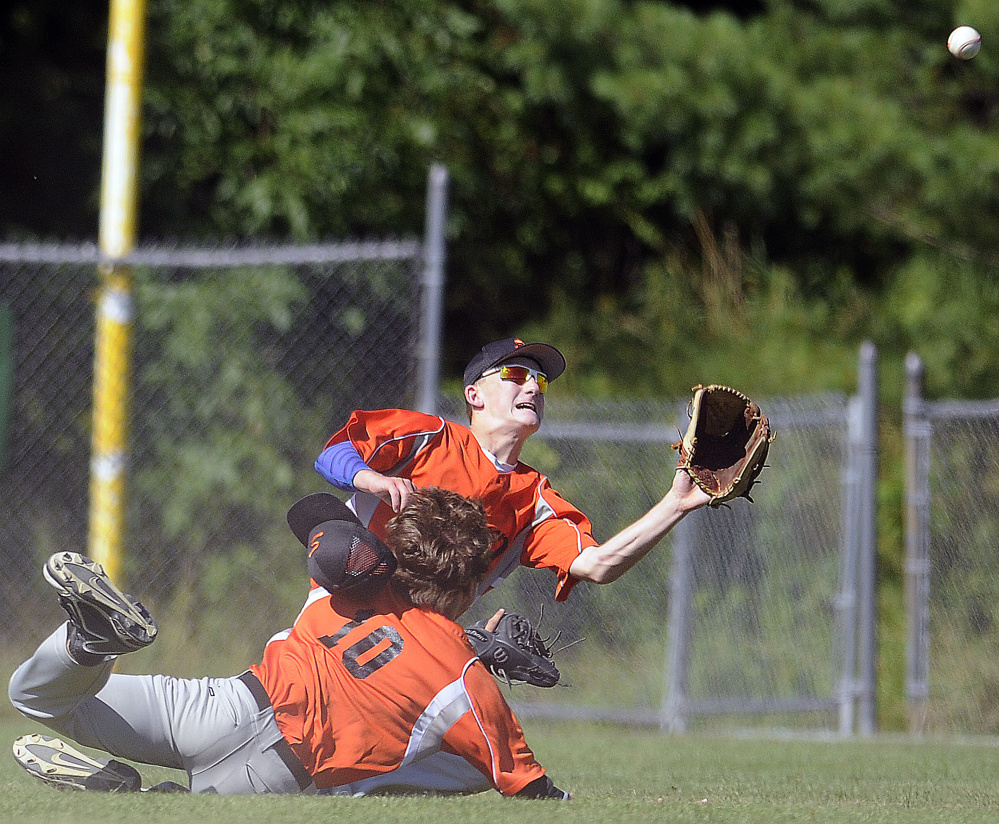 Evan Bess of Skowhegan, right, prepares to catch a short fly ball after colliding with teammate Adam Turcotte in right field during the 11-3 loss to Yankee Ford in the American Legion baseball state tournament Wednesday at Augusta.