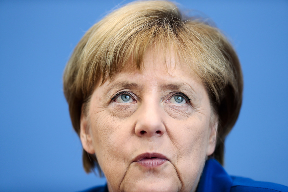 German Chancellor Angela Merkel addresses the media during a news conference in Berlin in July.