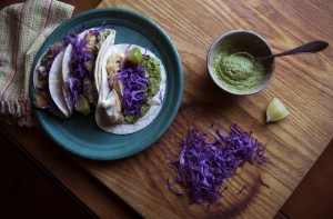 Cilantro-and-corn pesto fish tacos are made with a quick and easy five-minute pesto.