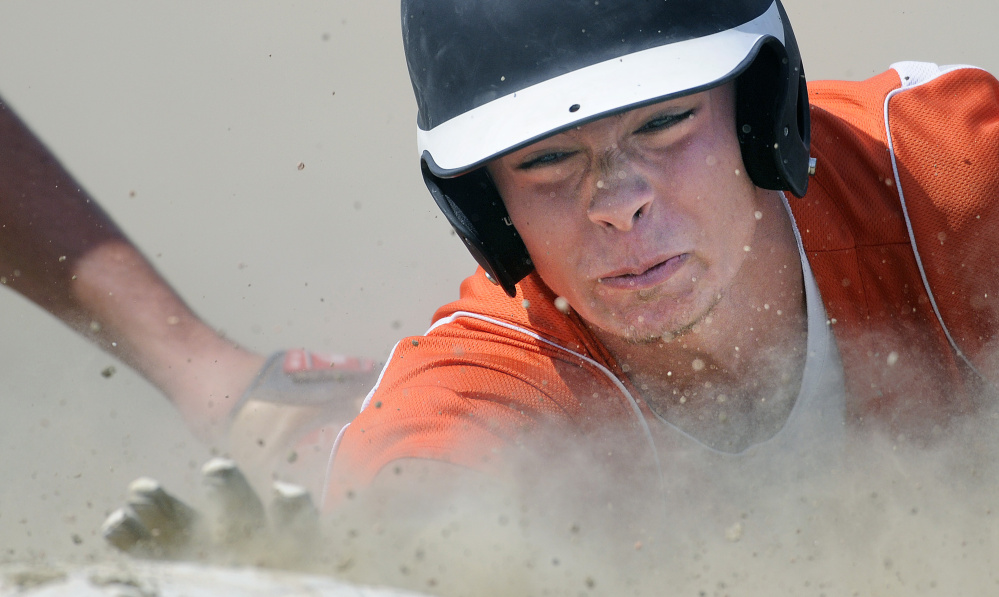Dustin Crawford of Skowhegan is tagged out while sliding into third base Thursday during the American Legion state tournament. Didn't matter. Skowhegan beat Fayette-Staples 14-2 in an elimination game.