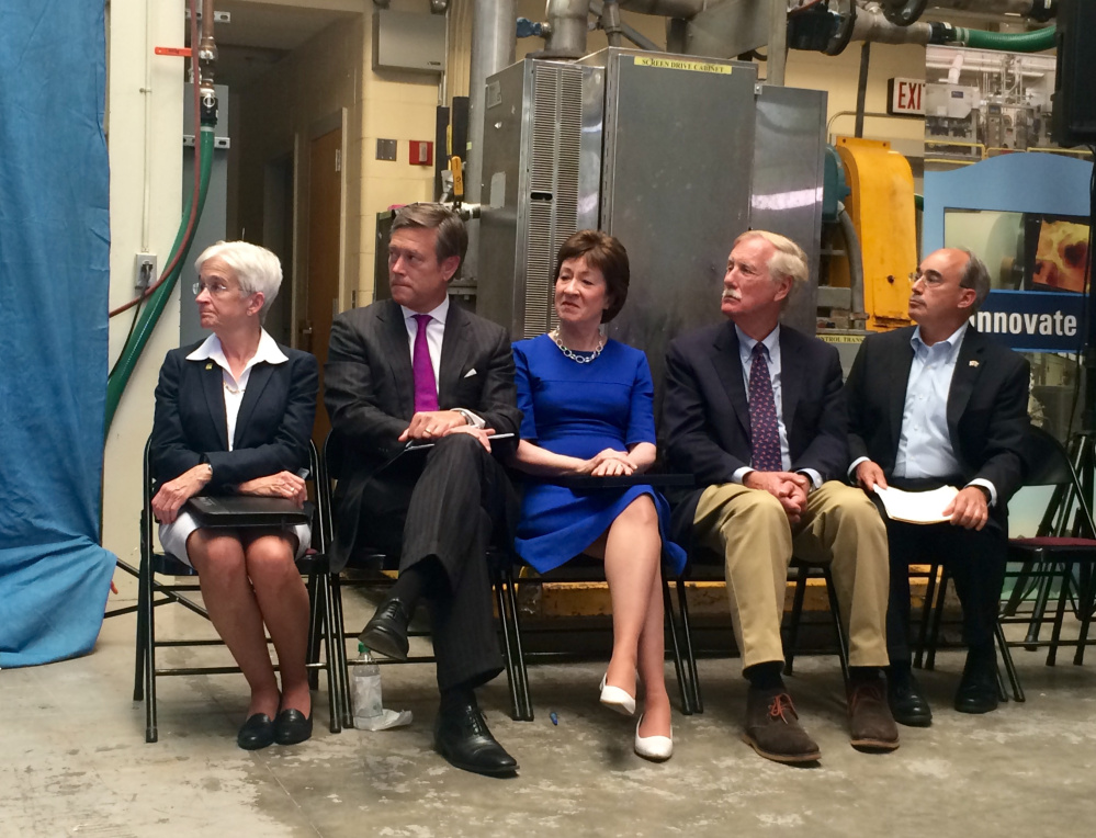 From left to right, University of Maine President Susan Hunter; Matt Erskine, U.S. Deputy Assistant Director of Commerce for Economic Development; U.S. Sen. Susan Collins; U.S. Sen. Angus King and U.S. Rep. Bruce Poliquin listen to remarks at a press conference Friday announcing plans for the federal government to invest in and assess the state's forest products industry. Staff photo by Rachel Ohm.
