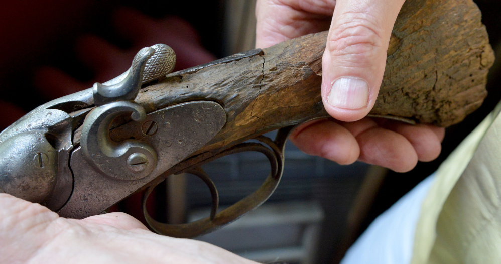 Bill Lessard found this sawed-off shotgun in 1970 in a window well at the former Hathaway shirt factory on Appleton Street in Waterville. He donated it to the Redington Museum in Waterville Thursday.