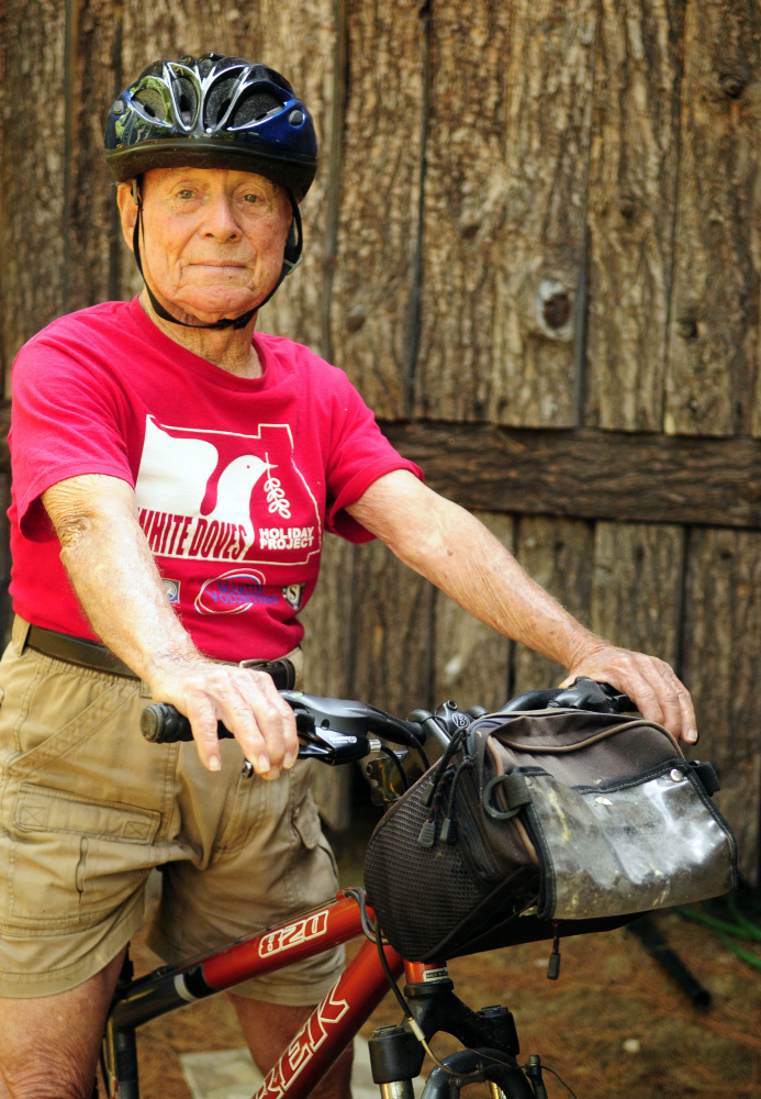 Alfred Jacobs, 92, poses on his bike Tuesday near his summer home in Readfield.
