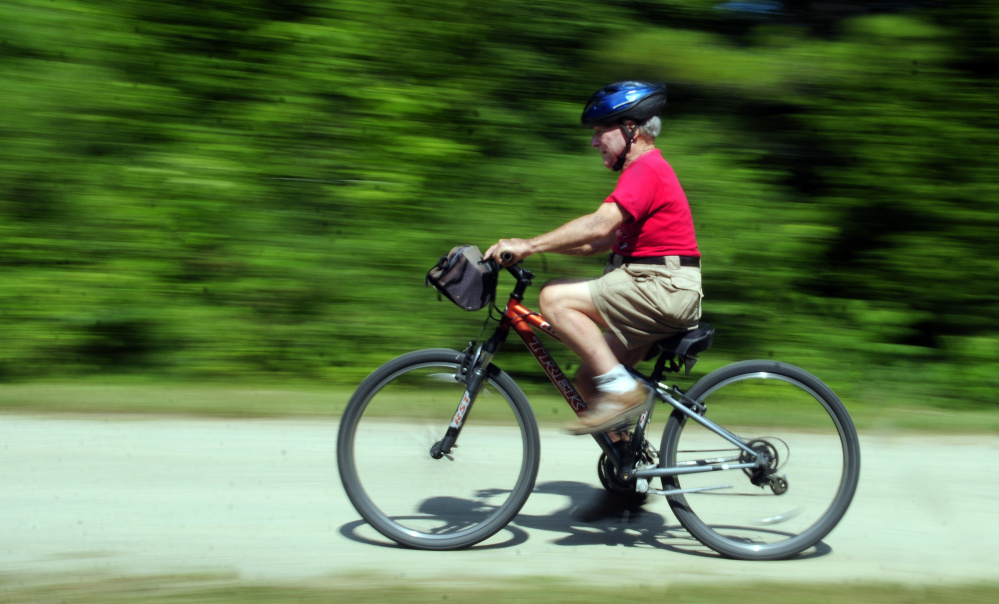 Alfred Jacobs, 92, rides his bike Tuesday near his summer home in Readfield.