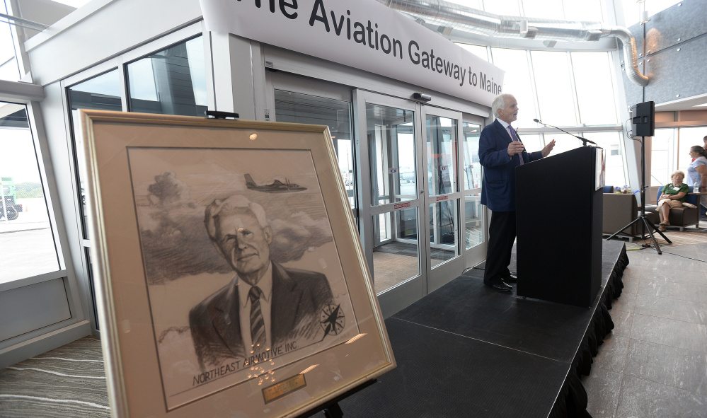 Henry Laughlin III, owner and president of Northeast Air, speaks Friday as his company unveils its new private facility at the Portland International Jetport.