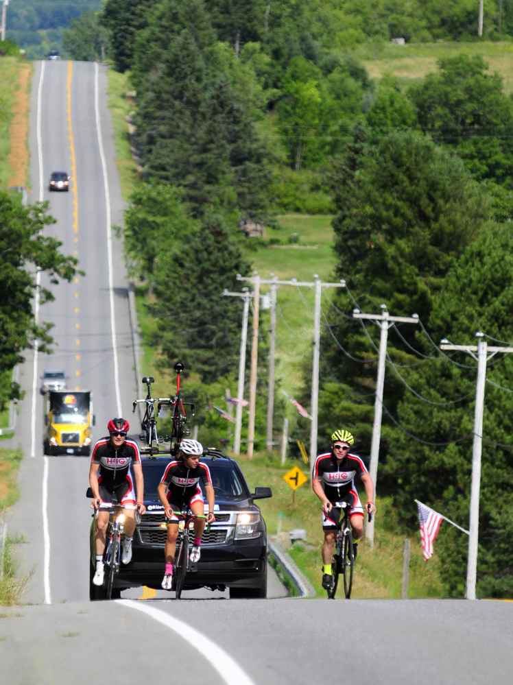 The Ride4Gabe team heads south Friday on U.S. Route 202 in Troy.