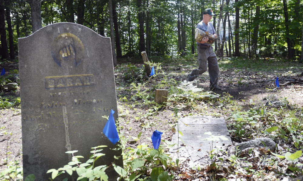 Ken Mann of the Mann Cemetery Association works at the Freeport cemetery. The association wants improved access to the site.