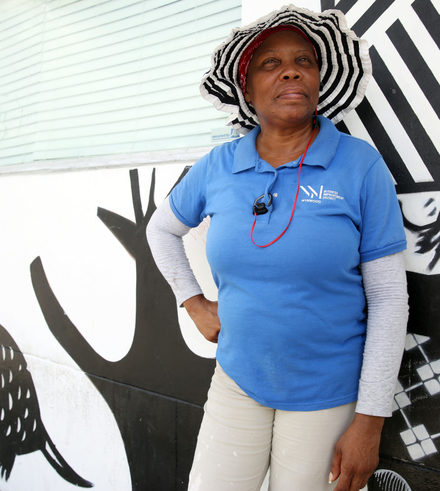 Glendina Rosebo takes a break from cleaning the sidewalks in the Wynwood area of Miami on Friday, where four patients were infected with Zika.